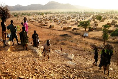 Children play near a site for displaced families in eastern Chad.