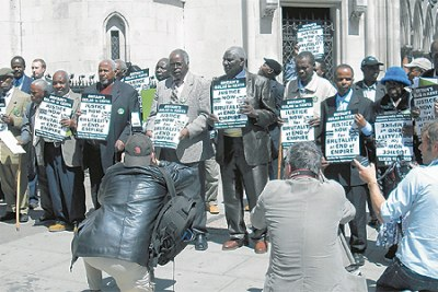 Mau Mau war veterans and their sympathisers outside No 10 Downing Street, the British Prime Minister's residence where they handed in their reparation petition.