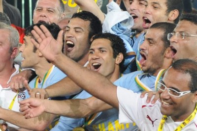 Egypt players celebrate winning during the 2010 Africa Cup of Nations final match.
