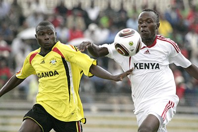 Kenya's Kevin Omondi battles Henry Kisseka of Uganda during their CHAN return tie at the Nyayo National Stadium.
