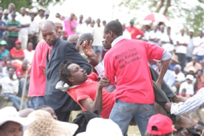 An MDC-T activist is ejected from Chibuku Stadium after skirmishes at the party's rally in Chitungwiza