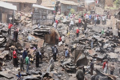 Residents of Mathare 10 area salvage property after an overnight fire: The cause of the fire is still unknown but there are reports that an illegal electricity connection is to blame.