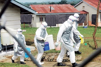 Medical workers in protective gear leave an Ebola isolation camp during the 2007 outbreak (file photo).
