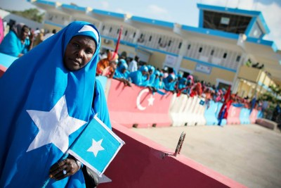 A woman dressed in the colours of the Somali flag.