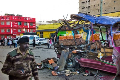 A policeman walks past the remains of a public minibus blown in Kenya (file photo).