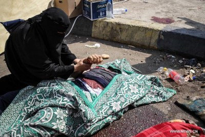 An Egyptian woman mourns a dead protester (file photo).