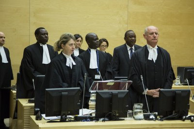 President Uhuru Kenyatta among his defence lawyers at the International Criminal Court (file photo)
