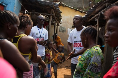 Volunteer in Freetown go door-to-door to educate residents about the modes of transmission of Ebola (file photo).