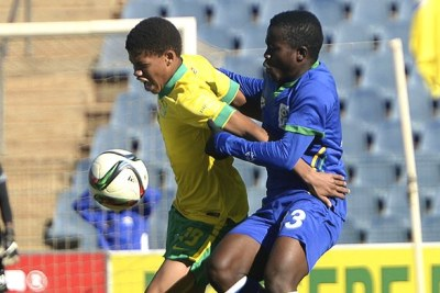 South Africa's U-17 player fights for a ball during a match against Tanzania.