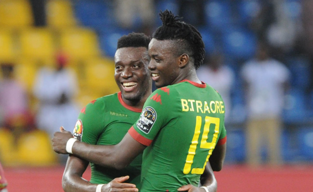 Alain Traore, left, who scored with a superb free-kick to seal the bronze medal for the Burkinabe, celebrates with his brother, Bertrand (no. 19).