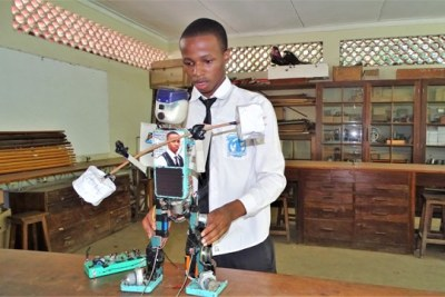 Form six student at Ilboru High School, Gracious Ephraim dispays his solar-powered human robot, which can walk, twist its head and speak at the Arusha-based school.