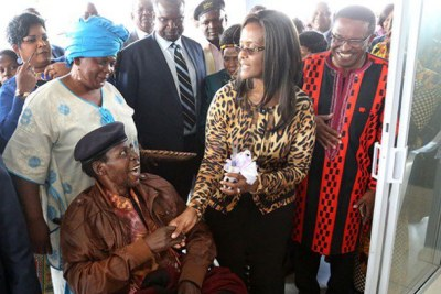 First Lady Grace Mugabe with Cde Chinx (seated in a wheelchair)'s house handover ceremony in Sentosa, Harare,