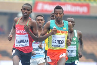 Kenya's Stanley Waithaka (left) battles Ethiopia's Barega Selemon in 3000m Heat One during the IAAF World Under-18 Athletics Championship.