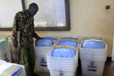 A police officer inspecting some of the ballot boxes at Shanzu Teachers College in Mombasa, on August 6, 2017.