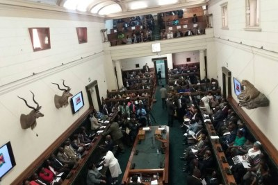 The House is almost full as the Speaker of Parliament, Jacob Mudenda walks in. Some opposition backbenchers shout