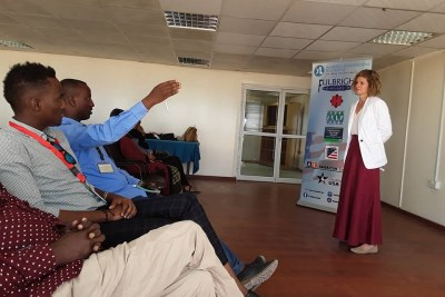 Political officer with the U.S. Somalia Mission Elizabeth Shackelford interacts with university students in Mogadishu (file photo).