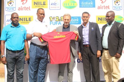 FUFA officials unveil new Cranes coach Sebastien Desabre.