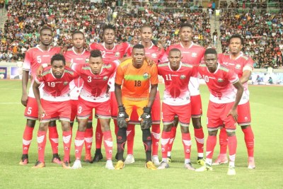 Harambee Stars players line up before a past friendly match against Iraq in Basra.