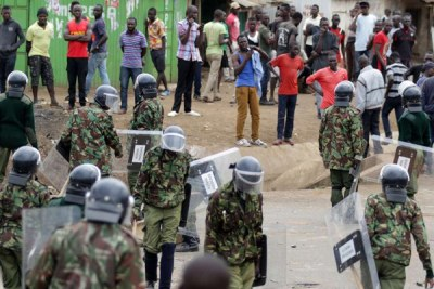 Anti-riot police officers attempt to disperse protesters in Kisumu County on August 12, 2017.