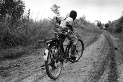 A child soldier rides back to his base in Ituri Province (file photo).