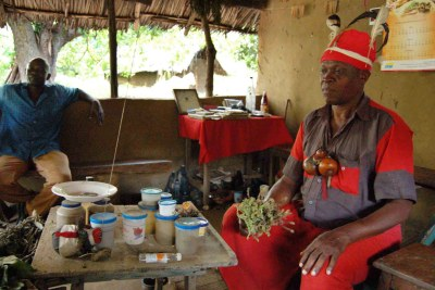 A traditional doctor explains the use of different herbs to cure diseases at the Kenyan coast in Ukunda, Kenya July 2007. A multi-sectoral approach will allow health systems use both modern and traditional medicine for more than 80 per cent of the population.