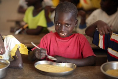 Children in Guinea-Bissau eating food donated by the World Food Programme.