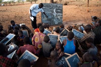 Instead of using notbooks and pens, teachers and students in Karamoja, Uganda turn to chalk boards (file photo).