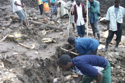 Residents dig through the rubble in the hope of finding survivors.
