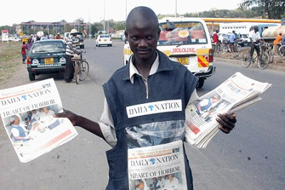 Vendor selling Nation Media Group papers.