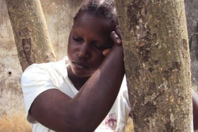 A woman who fled a previous attack (file photo): The Lord's Resistance Army reportedly killed hundreds of civilians during a four-day rampage in eastern DRC.