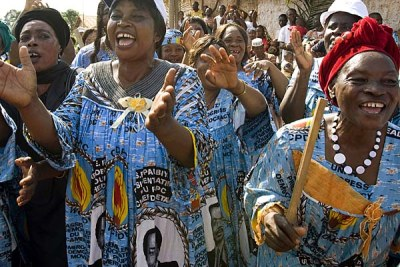 Women clad in dresses with the image of Cameroonian President Paul Biya.