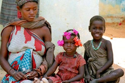 A Somali mother and two children waiting for food at a feeding centre in Mogadishu.
