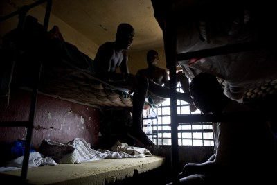 Monrovia Central Prison cells intended for two to four inmates are filled with up to ten or more inmates.