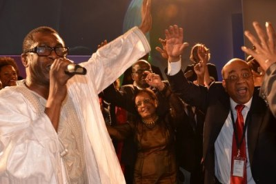 Youssou N'Dour, left, with Sudanese mobile phone pioneer Mo Ibrahim.