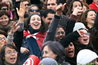 Tunisians celebrate.