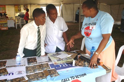 A volunteer in South Africa promoting awareness that Tuberculosis is curable.