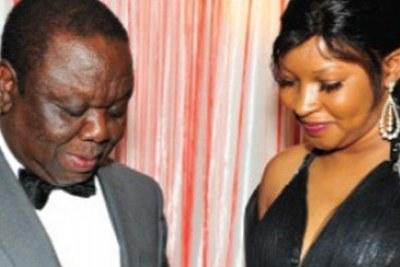 MDC-T leader, Morgan Tsvangirai, places an engagement ring on the finger of Elizabeth Macheka.