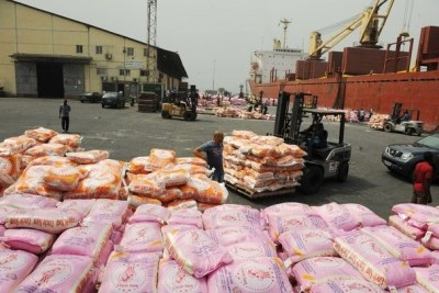 Rice prices in Cote d'Ivoire are still very high, but government attempts to fix prices are being resisted by traders. Imported rice at the port in Abidjan.