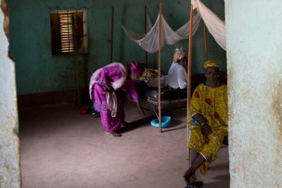 Female patients and medical workers in the maternity section at a community health centre in Mali.