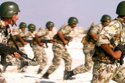 Egyptian Army Soldiers armed with 7.62mm AK-M assault rifles practice their beach assault techniques at El Omayed, Egypt as US, Spanish and Egyptian Forces conduct amphibious operations, during Exercise BRIGHT STAR 01/02.