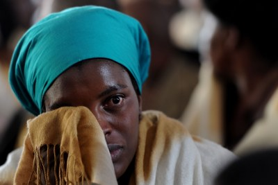 A woman cries at a memorial service for slain miners in Marikana.