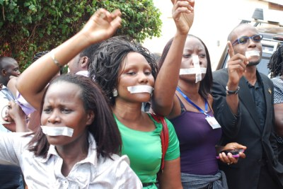 Human rights activists protest a police raid on a newspaper (file photo).