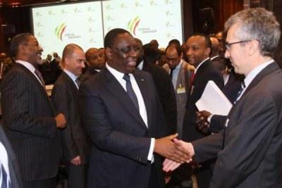 Le président Macky Sall très satisfait de la bonne moisson lors du Groupe Consultatif des 24 et 25 févier 2014 à Paris