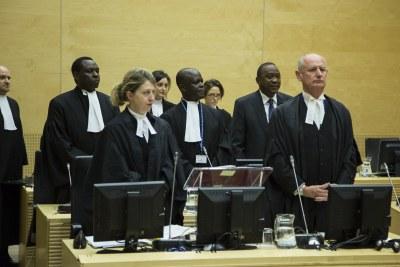 President Uhuru Kenyatta among his defence lawyers at the International Criminal Court (file photo).