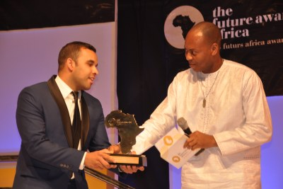 "R-L: Dr. Yinka Adedeji, Divisional Head, E-Banking, UBA Plc presenting an Award to Samir Ibrahim, Co-Founder of SunCulture, Kenya, winner ""the Future Africa Awards Prize in Agriculture,"" at the Future Awards ceremony in Lagos recently"