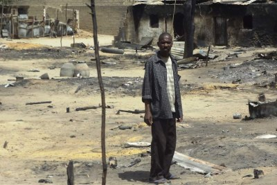 A man stands outside his destroyed home in Baga, Borno State, following heavy fighting between military forces from Nigeria, Niger and Chad, and Boko Haram (file photo).