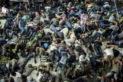 Rescued migrants sleep after being plucked from a boat off the coast of Italy in summer 2014. Most boat arrivals in 2014 were asylum seekers from Syria, Eritrea and elsewhere.