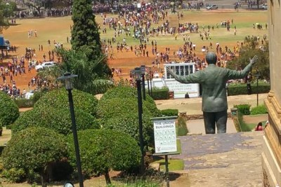 Students march to the Union Buildings to for a meeting between student leaders, university management and government.