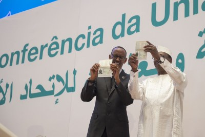 President Paul Kagame and President Idriss Deby Itno showing off the new passport (file photo).