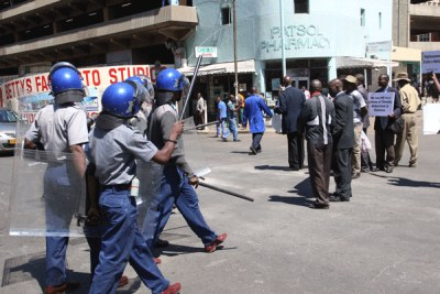Zimbabwe police patrolling in the country capital city, Harare.